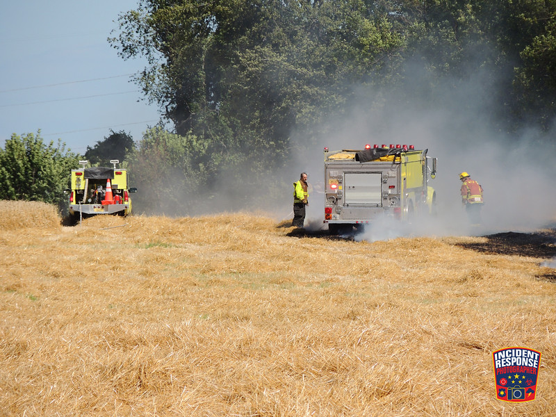 Firefighters from Waldo, City of Sheboygan Falls, Town of Sheboygan Falls, Plymouth and Oostburg responded to a combine and field fire on County Road M north of County Road U in the Town of Lima, Wisconsin on Friday, July 31, 2015. Photo by Asher Heimermann/Incident Response.
