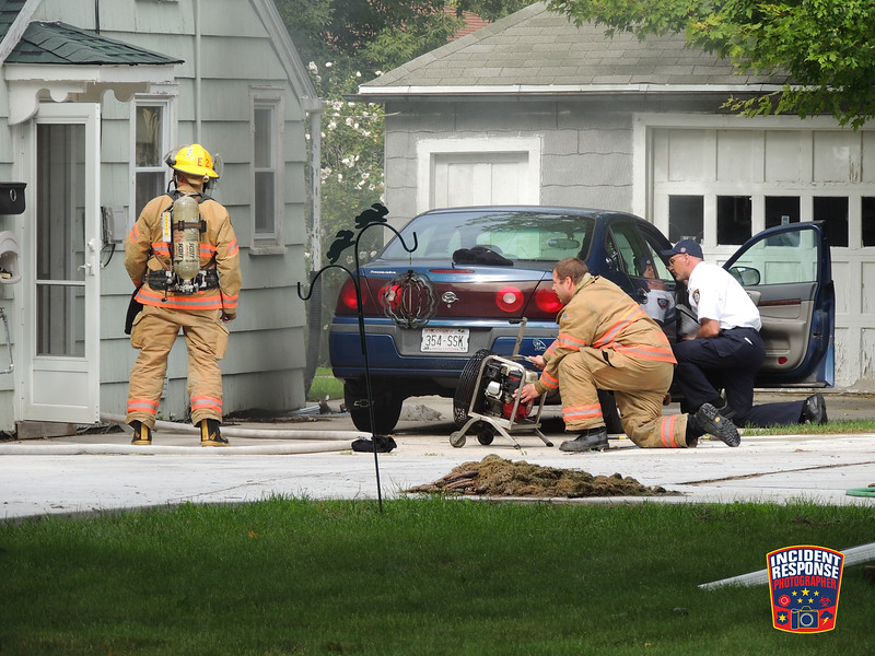 Firefighters responded to a report of smoke visible in the basement at 1906 Washington Avenue in Sheboygan, Wisconsin on Tuesday, September 29, 2015. Photo by Asher Heimermann/Incident Response.