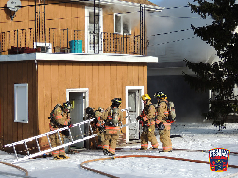 Firefighters responded to a house fire at 1915 Indiana Avenue in Sheboygan, Wisconsin on Sunday, January 17, 2016. Photo by Asher Heimermann/Incident Response.
