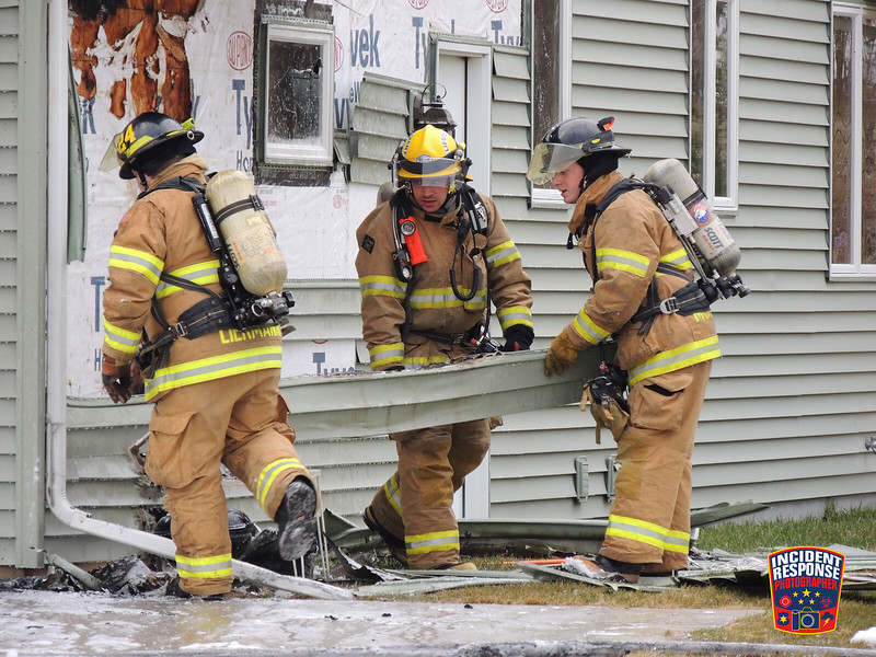 Firefighters extinguished an attached garage fire at 215 North 6th Street in Sheboygan Falls, Wisconsin on Tuesday, March 15, 2016. Photo by Asher Heimermann/Incident Response.