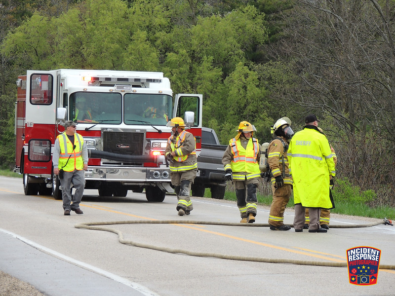 The Johnsonville and Town of Sheboygan Falls fire departments responded to a vehicle fire at County Road TT & State Highway 23 in the Town of Sheboygan Falls, Wisconsin on Friday, May 13, 2016. Photo by Asher Heimermann/Incident Response.