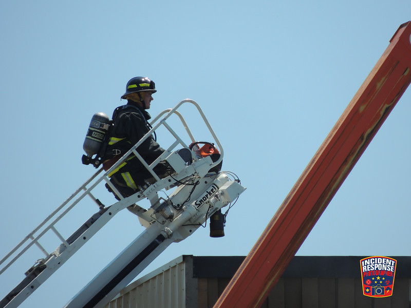 Firefighters responded to a roof fire at Lakeside Foods, 709 Allen Street in Random Lake, Wisconsin on Friday, June 17, 2016. Photo by Asher Heimermann/Incident Response.