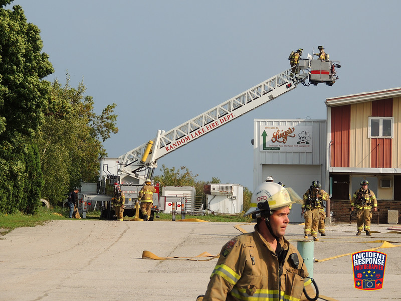 Firefighters responded for a report of a fire on the roof at Luige's Frozen Pizza on County Road K near Cedar Grove, Wisconsin on Friday, September 16, 2016. Photo by Asher Heimermann/Incident Response.