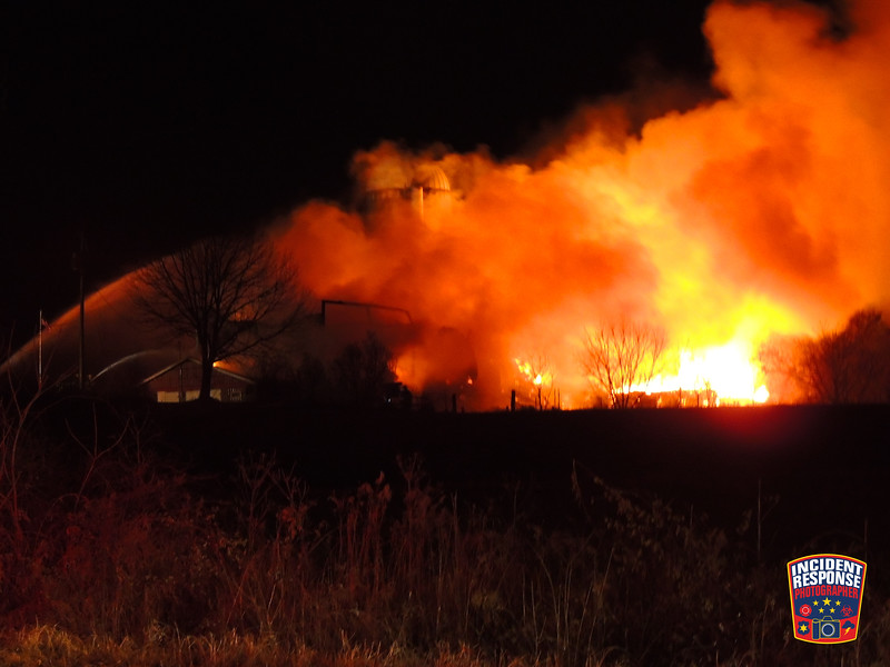 Firefighters responded to a 3-alarm barn fire on Pheasant Valley Road west of State Highway 57 near Waldo, Wisconsin on Friday, December 1, 2017. Photo by Asher Heimermann/Incident Response.