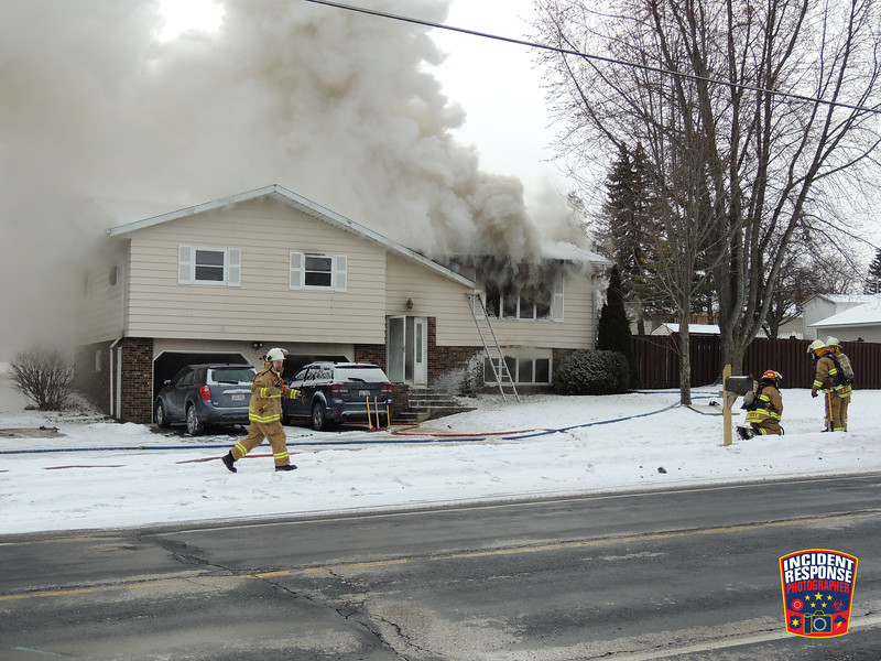 Sheboygan County firefighters responded to a house fire at 1005 College Avenue in Howards Grove, Wisconsin on Friday, December 29, 2017. Photo by Asher Heimermann/Incident Response.