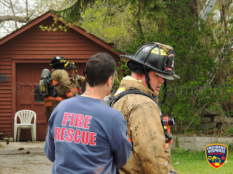 A mother was injured in a house fire near North 4th Street & Wisconsin Avenue in Sheboygan, Wisconsin on Tuesday, May 9, 2017. Photo by Asher Heimermann/Incident Response.