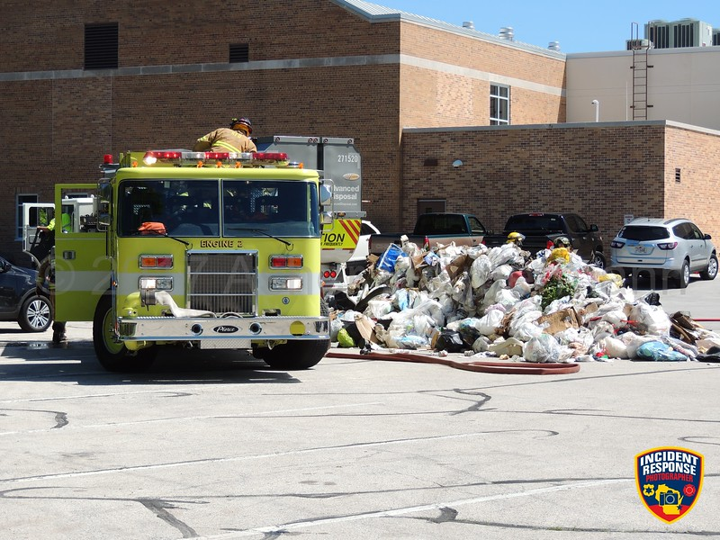 Firefighters extinguished a fire that started in a garbage truck behind the Sheboygan Falls Fire Station on Wednesday, June 7, 2017. Photo by Asher Heimermann/Incident Response.