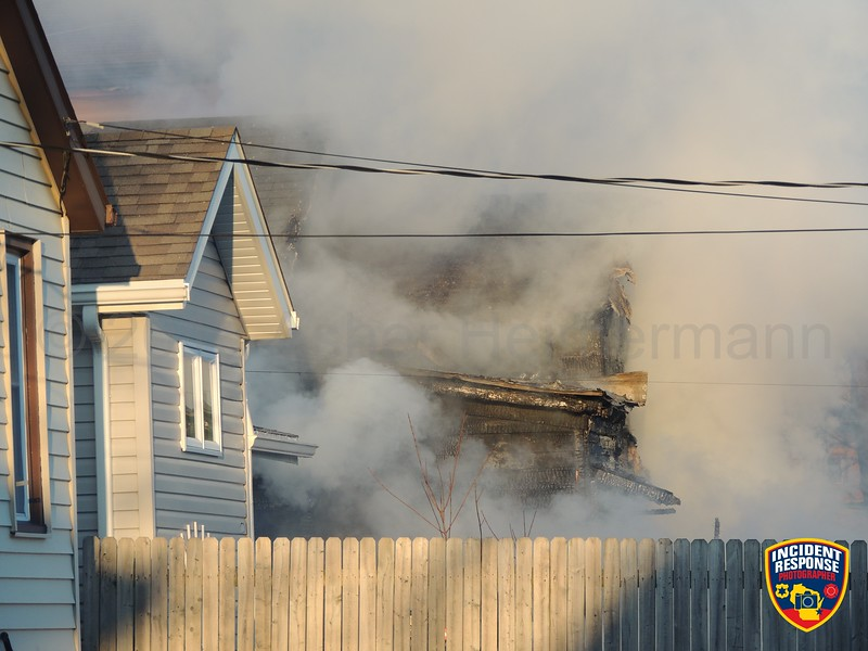 Firefighters responded to a house fire at 831 Jackson Avenue in Sheboygan, Wisconsin on Saturday, March 17, 2018. Photo by Asher Heimermann/Incident Response.
