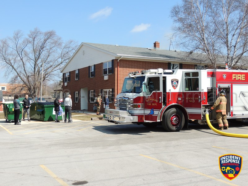 Firefighters responded to an apartment building fire at 3510 South 12th Street in Sheboygan, Wisconsin on Wednesday, April 11, 2018. Photo by Asher Heimermann/Incident Response.