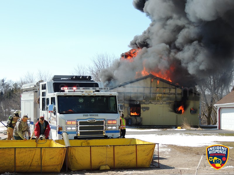 Firefighters responded to a garage fire at N6220 Rio Road in the Town of Sheboygan Falls, Wisconsin on Thursday, April 4, 2018. Photo by Asher Heimermann/Incident Response.