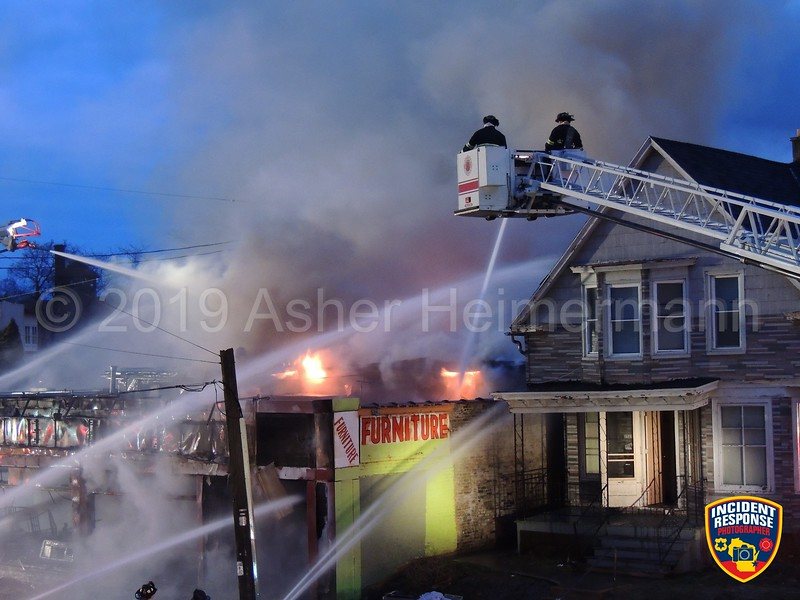 Firefighters battled a 3-alarm fire at the Furniture Depot store on Lincoln Avenue near Forest Home Avenue in Milwaukee, Wisconsin on Saturday, April 13, 2019. Photo by Asher Heimermann/Incident Response.
