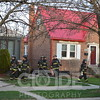 Chicago Fire Department on scene of a small house fire on Monitor Avenue. Fire was in the rear of the red roofed house. All photo's will NOT have watermark when purchased.
