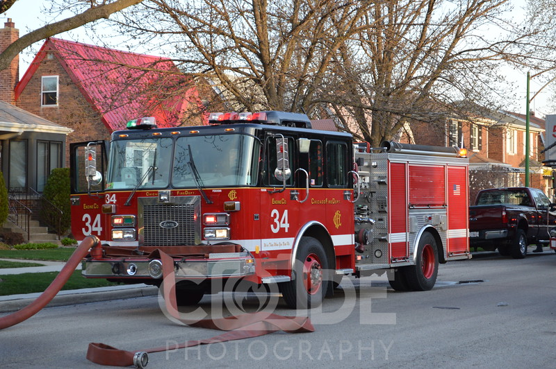 Chicago Fire Department on scene of a small house fire on Monitor Avenue. All photo's will NOT have watermark when purchased.