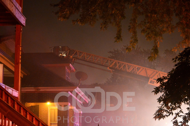 Chicago Fire Department on scene of a house fire with extensions to a neighboring house, resulting in a still and box alarm.