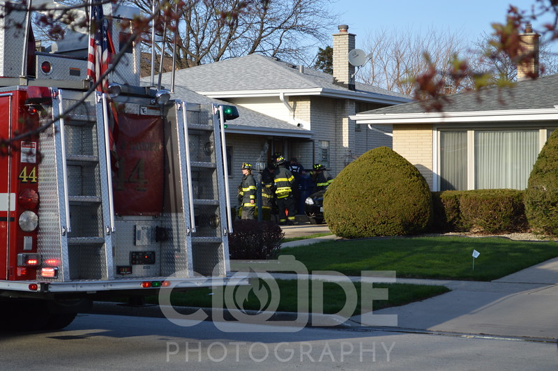 Evergreen Park Fire Department on scene of a small house fire. Light smoke showing on arrival. All photo's will NOT have watermark when purchased.