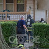 Harvey Fire Department on scene of a house fire with fire in the basement.