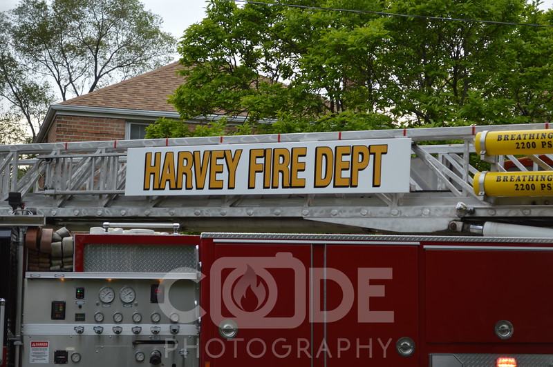 Harvey Fire Department on scene with a house fire. They had water supply issues and flames through the roof.