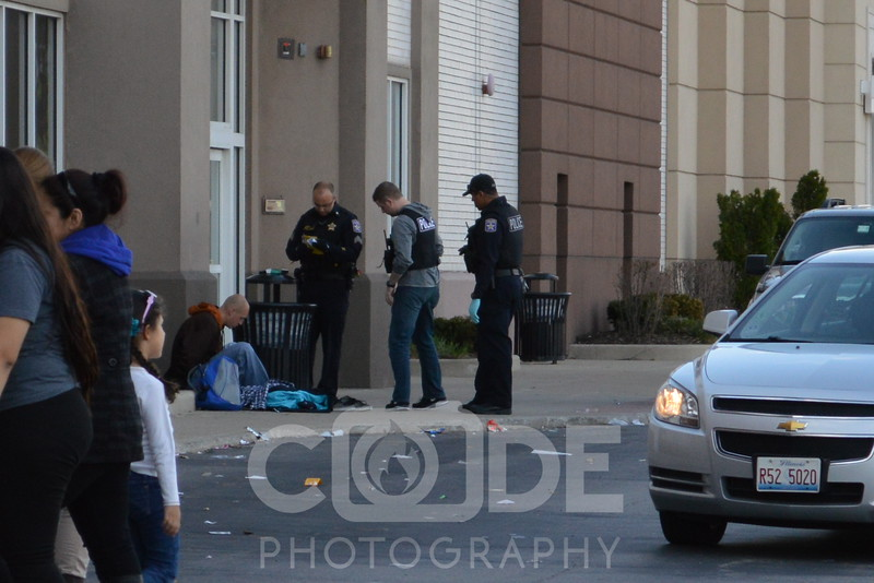North Riverside Police detain a suspect at the North Riverside Mall. All photo's will NOT have watermark when purchased.