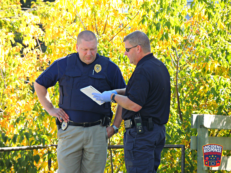 Sheboygan Police investigate the deaths of two people found inside a home at 1423 Erie Avenue in Sheboygan, Wisconsin on Sunday, October 11, 2015. Photo by Asher Heimermann/Incident Response.