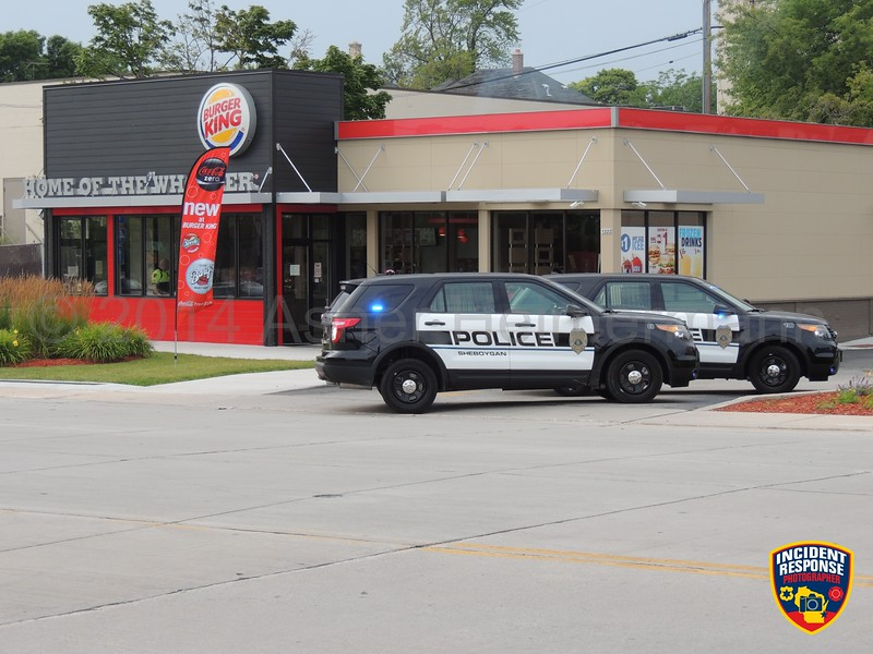 Police responded to a reported robbery at Burger King on Erie Avenue and later discovered it was a dispute over money on Sunday, August 3, 2014. Photo by Asher Heimermann/Incident Response.