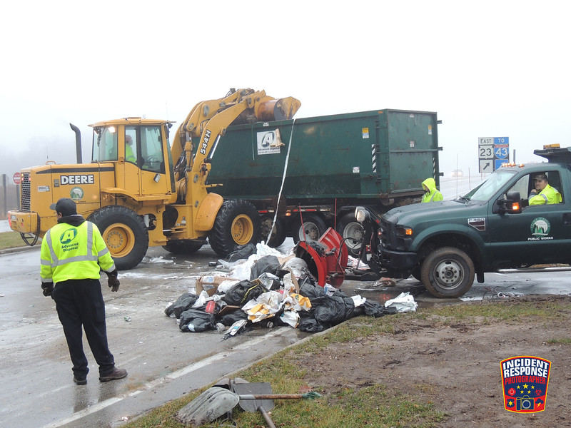 Crews work to remove garbage from Highland Drive in Kohler, Wisconsin on Wednesday, December 4, 2013. Photo by Asher Heimermann/Incident Response.