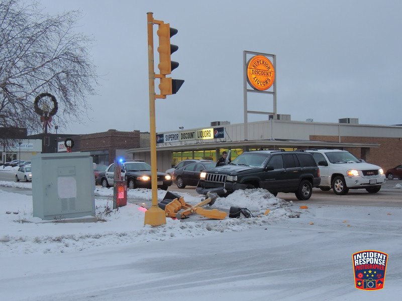 Single vehicle crash involving a traffic light at South 8th Street & Riverfront Drive in Sheboygan, Wisconsin on Friday, December 20, 2013. Photo by Asher Heimermann/Incident Response.