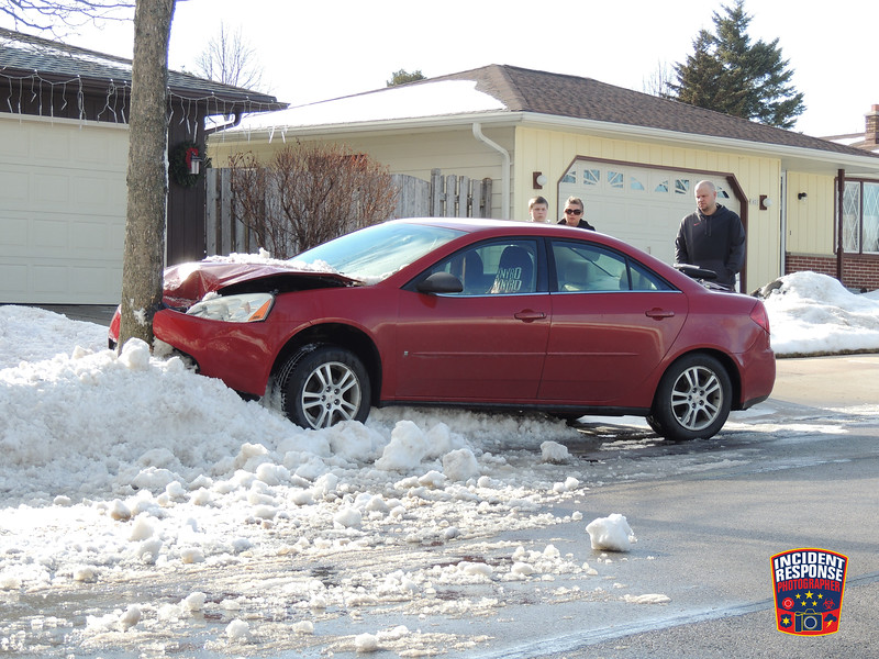 Single vehicle crash involving a tree in the 1800 block of Carmen Avenue in Sheboygan, Wisconsin on Monday, January 13, 2014. Photo by Asher Heimermann/Incident Response.