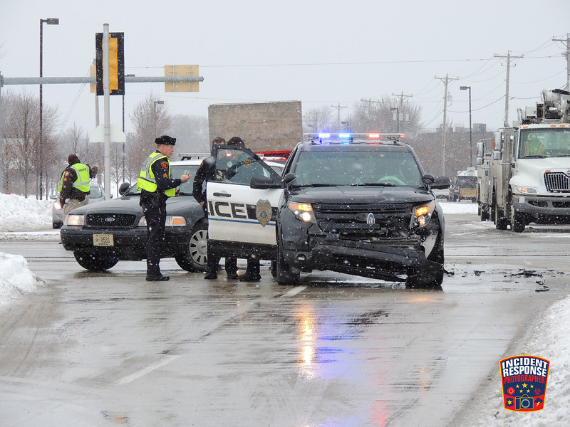 Two-vehicle crash with injuries involving a Sheboygan Police vehicle at South Taylor Drive & Washington Avenue in Sheboygan, Wisconsin on Friday, January 17, 2014. Photo by Asher Heimermann/Incident Response.
