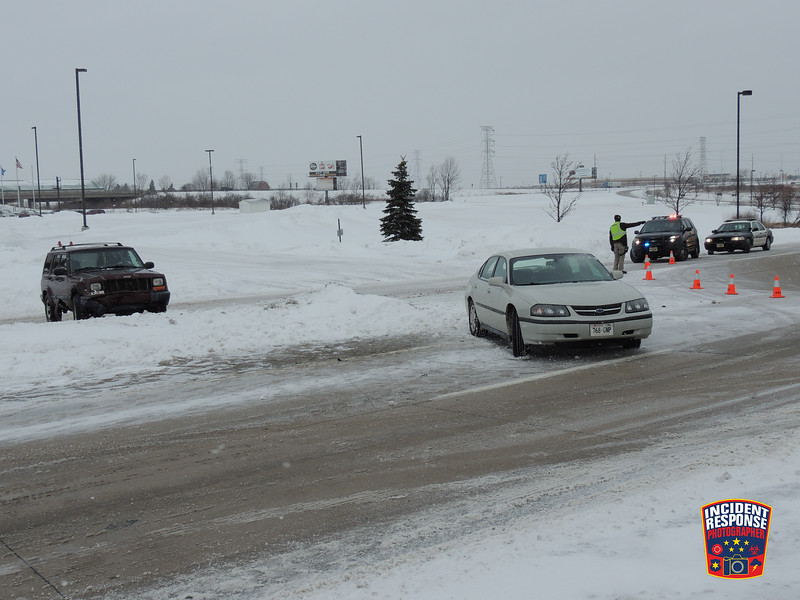 Two-vehicle crash with injuries at South Taylor Drive & Behrens Parkway in Sheboygan, Wisconsin on Friday, January 17, 2014. Photo by Asher Heimermann/Incident Response.