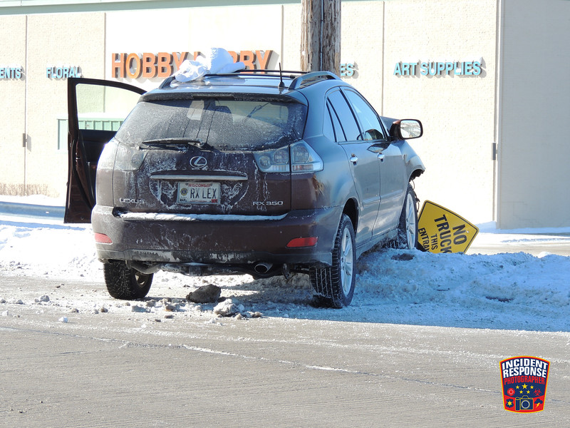 Single vehicle crash involving a power pole on North Taylor Drive near Highway 23 in Sheboygan, Wisconsin on Monday, January 27, 2014. Photo by Asher Heimermann/Incident Response.
