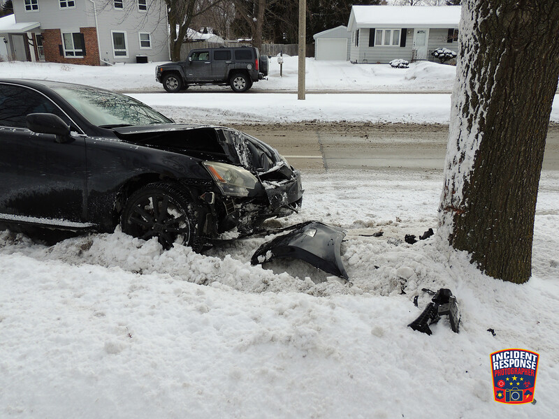 Single vehicle crash involving a tree at North 31st Street & North Avenue in Sheboygan, Wisconsin on Thursday, February 6, 2014. Photo by Asher Heimermann/Incident Response.