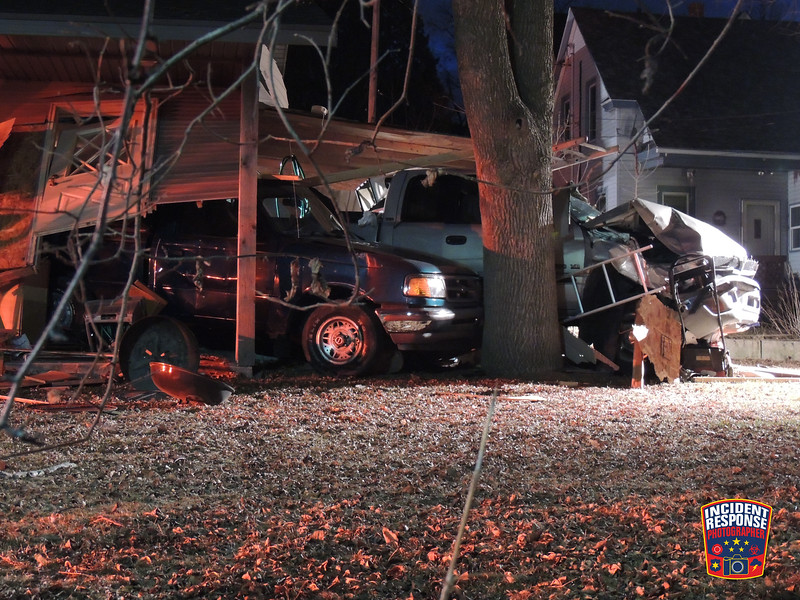 A vehicle crashed into a garage in the 400 block of Niagara Avenue in Sheboygan, Wisconsin on Saturday, March 22, 2014. Photo by Asher Heimermann/Incident Response.