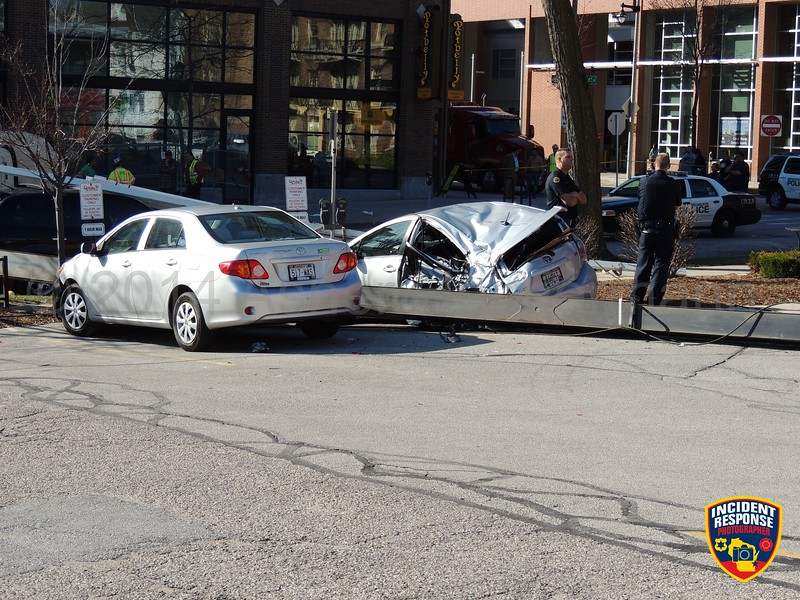 A strong gust of wind apparently caused a crane to overturn on Prospect Avenue near North Avenue in Milwaukee, Wisconsin on Friday, May 9, 2014. Photo by Asher Heimermann/Incident Response.