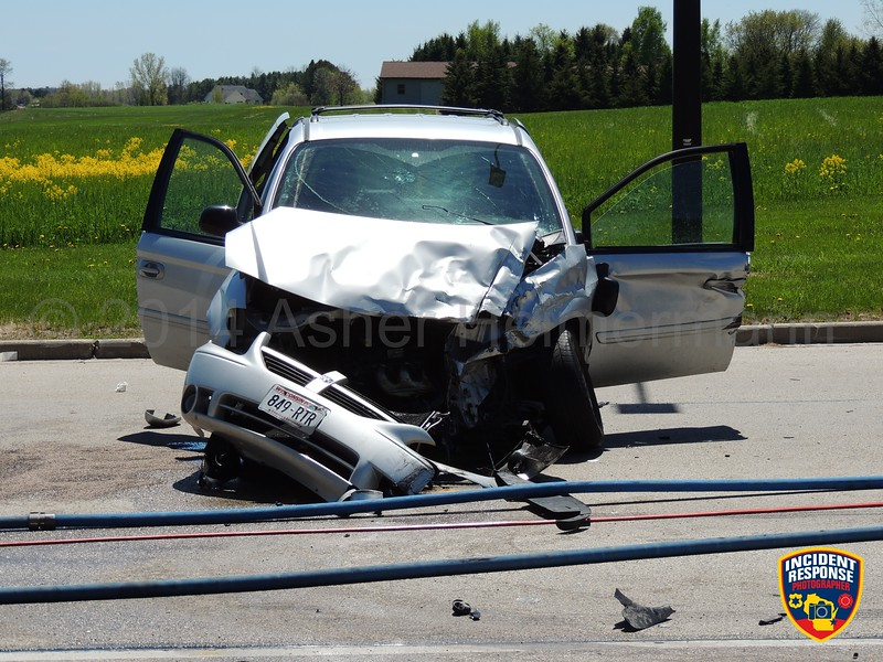 Rollover crash with injuries at Center Avenue & North Sauk Trail Road in Oostburg, Wisconsin on Friday, May 23, 2014. Photo by Asher Heimermann/Incident Response.