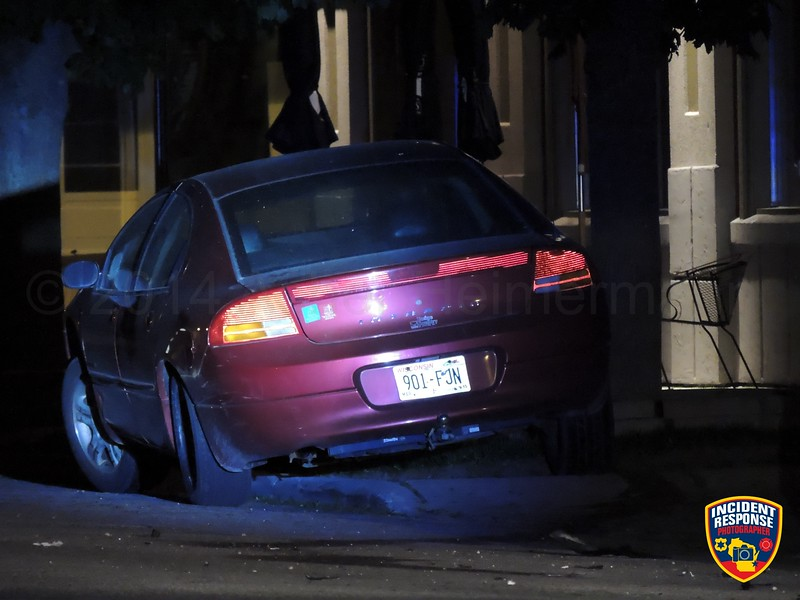 A suspected drunk driver crashed into a parked car and tree in the 800 block of St. Clair Avenue in Sheboygan, Wisconsin on Sunday, June 8, 2014. Photo by Asher Heimermann/Incident Response.