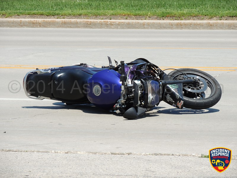 Motorcycle vs. vehicle accident in front of 4016 Highway 42 in Sheboygan, Wisconsin on Monday, June 9, 2014. Photo by Asher Heimermann/Incident Response.