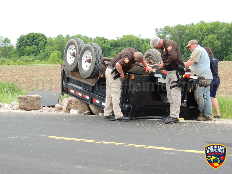 A trailer flipped over on County Road A west of Highway 32 in Oostburg, Wisconsin on Tuesday, June 10, 2014. Photo by Asher Heimermann/Incident Response.