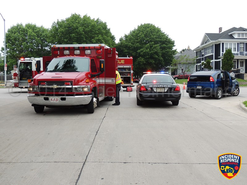 A vehicle hit a child on a bicycle at North 14th Street & Huron Avenue in Sheboygan, Wisconsin on Saturday, June 21, 2014. Photo by Asher Heimermann/Incident Response.