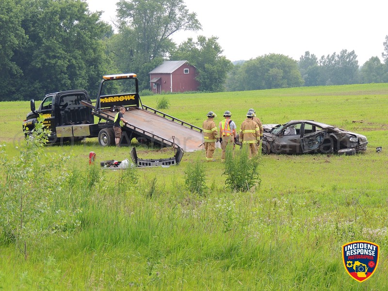 Single vehicle rollover crash on County Road M south of Hillside Road in the Town of Sheboygan Falls, Wisconsin on Saturday, June 28, 2014. Photo by Asher Heimermann/Incident Response.