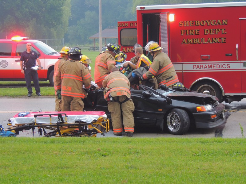 Two-vehicle accident with injuries on South 17th Street near River Park Road in Sheboygan, Wisconsin on Saturday, July 12, 2014. Photo by Asher Heimermann/Incident Response.
