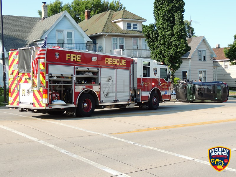 Single vehicle rollover accident on Erie Avenue near North 15th Street in Sheboygan, Wisconsin on Friday, July 18, 2014. Photo by Asher Heimermann/Incident Response.