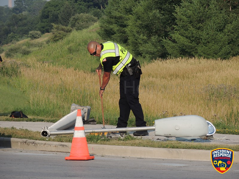 Single vehicle accident involving a light pole at Highway 28 & Highway 32 in Sheboygan Falls, Wisconsin on Monday, July 21, 2014. Photo by Asher Heimermann/Incident Response.