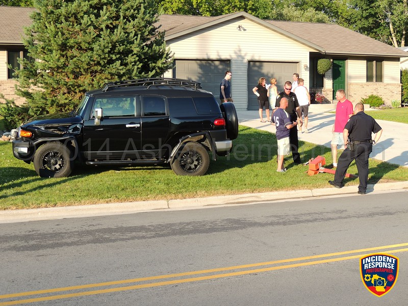 An SUV crashed into a parked car and mailbox in front of 1024 Broadway Street in Sheboygan Falls, Wisconsin on Tuesday, July 22, 2014. Photo by Asher Heimermann/Incident Response.