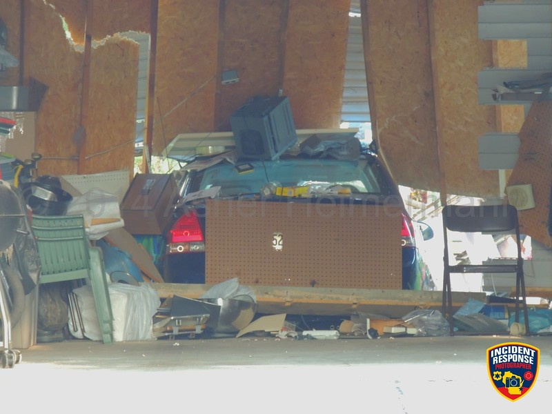 A car crashed into a light pole and into a garage near North 36th Street & Gregory Drive in Sheboygan, Wisconsin on Thursday, July 31, 2014. Photo by Asher Heimermann/Incident Response.