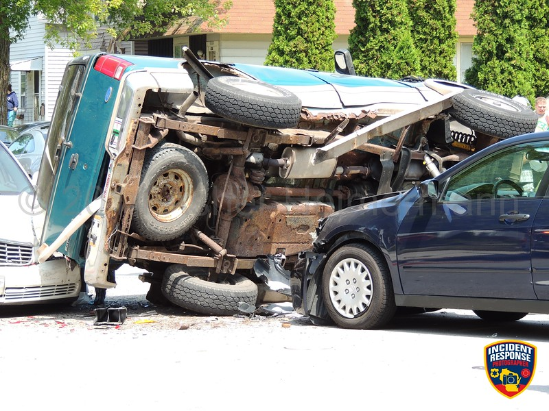 Three-vehicle rollover accident at North 11th Street & Superior Avenue in Sheboygan, Wisconsin on Wednesday, August 6, 2014. Photo by Asher Heimermann/Incident Response.