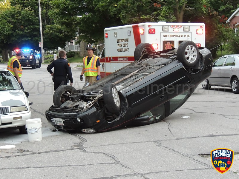 A car hit a parked vehicle and rolled over in the 1200 block of South 15th Street in Sheboygan, Wisconsin on Tuesday, August 12, 2014. Photo by Asher Heimermann/Incident Response.