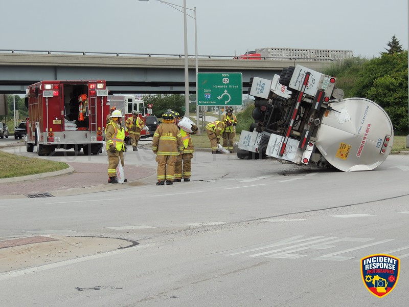 A semi tanker tipped over on Highway 42 at Interstate 43 in the Town of Sheboygan, Wisconsin on Thursday, August 21, 2014. Photo by Asher Heimermann/Incident Response.