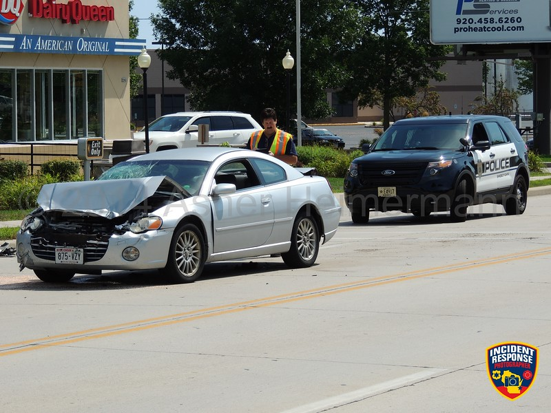 Two-vehicle accident in the 2200 block of Calumet Drive in Sheboygan, Wisconsin on Thursday, August 28, 2014. Photo by Asher Heimermann/Incident Response.