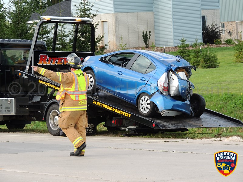 Two-vehicle accident at North Main Street & Hamann Drive in Sheboygan Falls, Wisconsin on Tuesday, September 2, 2014. Photo by Asher Heimermann/Incident Response.