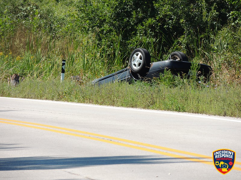 Single vehicle rollover involving a power pole on County Road I near County Road M in Hingham, Wisconsin on Tuesday, September 9, 2014. Photo by Asher Heimermann/Incident Response.